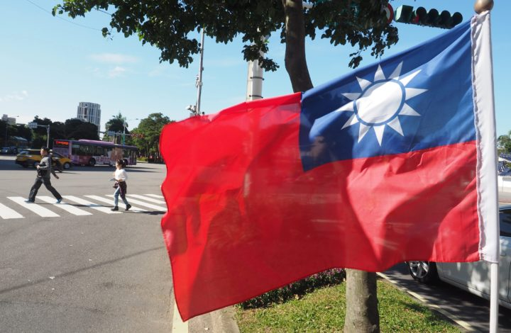 epa05684184 Pedestrians walk past a Taiwanese national flag at a road crossing in Taipei, Taiwan, 21 December 2016. According to reports on 21 December 2016, Taiwan said that Sao Tome and Principle - one of Taiwan's 22 diplomatic allies - cut ties with Taipei to recognize China. Taiwan's Presidential Office blasted China for using dollar diplomacy to lure away Sao Tome and Principe when the Western African nation is in financial crisis. China's Foreign Ministry welcomed Sao Tome and Principle's 'returning to the correct road' of the 'one China policy,' which says that there is only one China, andTaiwan is part of China.  EPA/DAVID CHANG