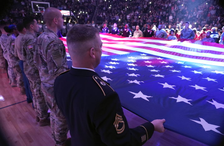 epa07161762 Members of the United States military stretch out the american flag during the national anthem and to honor Veterans Day at the NBA basketball game between the San Antonio Spurs and the Sacramento Kings at Golden 1 Center in Sacramento, California, USA, 12 November 2018.  EPA/JOHN G. MABANGLO  SHUTTERSTOCK OUT
