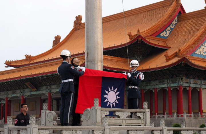 epa07436363 (FILE) - Soldiers hoist Taiwan's national flag at the Liberty Square in Taipei, Taiwan, 13 March 2019 (reissued on 14 March 2019). Taiwan welcomed El Salvadoran supreme court's temporary suspending the termination of El Salvador-Taiwan free trade agreement on 14 March 2019. 'We are pleased to see the positive development in this case. We respect the legal process in El Salvador and will also closely monitor development of political situation in El Salvador,' Foreign Ministry Spokesman Andrew Lee said. El Salvador cut diplomatic ties with Taiwan to recognize China on 21 August 2018 and also scrapped the trade deal in December 2018. But El Salvadoran business sector sought an injunction, saying that nixing the trade deal would hurt buinsess interest. In February 2019, El Salvador's president-elect Nayib Bukele, to be sworn in on 01 June 2019, said China does not respect El Salvador, so he will review his predecessor's decision on cutting ties with Taiwan. Taiwan, formally called the Republic of China (ROC), is recognized by 17 countries. China sees Taiwan as its breakaway province and urges Taiwan's allies to drop Taipei and recognize Beijing.  EPA/DAVID CHANG