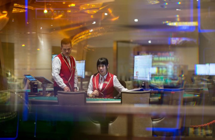 epa06520205 A dealer sits at a black jack table on the gaming floor of the MGM Cotai casino and resort a few hours before the opening in Macau, China, 13 February 2018. The US3.4 billion, Euros2.75 billion, integrated resort is the latest addition to Macau, the only territory of China where gambling is legal.  EPA/JEROME FAVRE