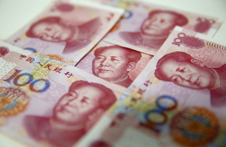 epa04986232 (FILE) A file picture dated 12 August 2015 shows Chinese yuan banknotes in Beijing, China, 12 August 2015. According to media reports on 21 October 2015, People's Bank of China (PBC or PBOC), the central bank of China, launched a yuan-denominated bond auction in London, Britain. The move, said to be made for the first time outside of China, intends to internationalize China's currency facilitating cross-border trade and investment in the offshore market. The note, worth five billion yuan (about 690 million euro or 786 million US dollar), has an interest rate of 3.15 percent and its falls are due in 2016. The central bank's announcement was made as Chinese President Xi Jinping is in Britain on a four-day official visit.  EPA/WU HONG