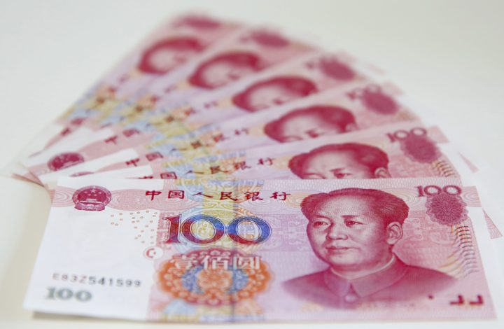 epa04986231 (FILE) A file picture dated 12 August 2015 shows Chinese yuan banknotes in Beijing, China, 12 August 2015. According to media reports on 21 October 2015, People's Bank of China (PBC or PBOC), the central bank of China, launched a yuan-denominated bond auction in London, Britain. The move, said to be made for the first time outside of China, intends to internationalize China's currency facilitating cross-border trade and investment in the offshore market. The note, worth five billion yuan (about 690 million euro or 786 million US dollar), has an interest rate of 3.15 percent and its falls are due in 2016. The central bank's announcement was made as Chinese President Xi Jinping is in Britain on a four-day official visit.  EPA/WU HONG