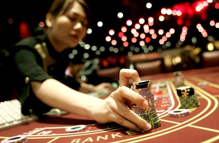 epa00799946 A dealer gathers gaming chips at the newly opened 'Treasure Level' at the Sands Casino in Macao, Wednesday, 23 August 2006 By adding a further 273 gaming tables over more than 64,000 square feet of space on three floors, the casino owned and operated by the Las Vegas Sands Corporation increased it's size by 58per cent. This increase makes it now the largest casino in the world. The casino now accommodates a total of 740 gaming tables and 1,254 slot machines.  EPA/ALEX HOFFORD