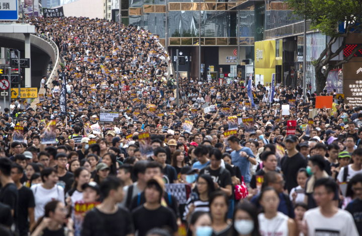 epaselect epa07700888 Anti-extradition bill protesters take part in a march to West Kowloon railway station in Hong Kong, China, 07 July 2019. According to the events organizers, the march aims to spread the spirit of resistance all over Hong Kong Island to Kowloon and even to Mainland China.  EPA/CHAN LONG HEI