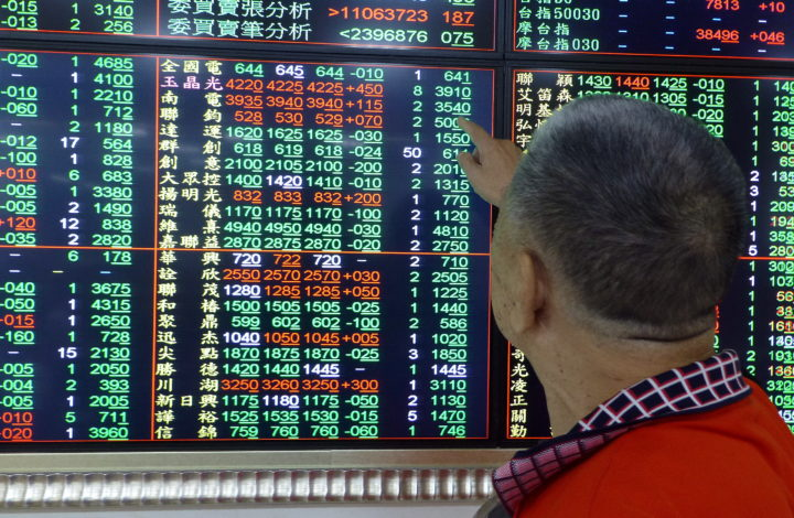 epa07758956 A man watches a monitor at a stock exchange in Taipei, Taiwan, 06 August 2019. Asiian stocks tumbled over as US Treasury department formally label China as a currency manipulator, after China's Renminbi fell through the key threshold of seven to the dollar on 05 August, amid escalation of US-China trade war. Major Asian stocks fell more than two per cent with Taiwan's TAIEX falling 2.4 per cent within three minutes of the stock market's opening.  EPA/DAVID CHANG