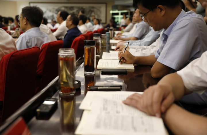 epa07688566 Students take notes during a class at the Party School of the Central Committee of the Communist Party of China (CCPS) during a visit organised for foreign journalists in Beijing, China, 26 June 2019 (issued 02 July 2019). The 86-year-old party school is an important institution for the Communist Party of China (CPC) for the training and education of its cadres and cultivation of government elites.  EPA/HOW HWEE YOUNG CHINA OUT