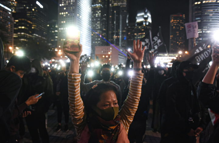 epa08065333 Pro-democracy protesters turn on the flash lights of their mobile phones during a rally marking the sixth month anniversary of the protests movement in Hong Kong, China, 12 December 2019. Hong Kong has entered its seventh month of mass protests, which were originally triggered by a now withdrawn extradition bill, and have since turned into a wider pro-democracy movement.  EPA/MIGUEL CANDELA