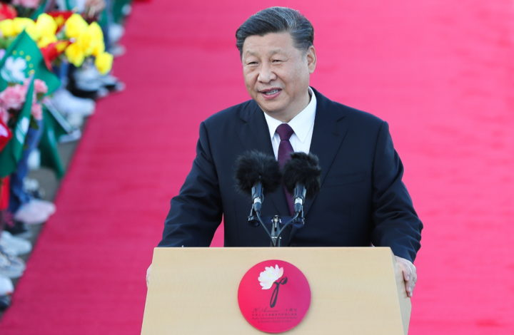 epa08078924 Chinese President Xi Jinping (C) speaks after his arrival at Macao International Airport in Macao, China, 18 December 2019. President Xi is in Macao to participate in the Macao Special Administrative Region of the People's Republic of China 20th anniversary celebrations. Macao was governed by Portugal until 1999 when it was transferred to China. As a special administrative region, Macao maintains separate governing and economic systems from that of mainland China.  EPA/JOAO RELVAS