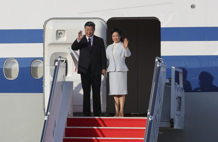 epa08078828 Chinese President Xi Jinping (L) is accompanied by his wife Peng Liyuan (R) as they arrive at Macao International Airport in Macao, China, 18 December 2019. President Xi is in Macao to participate in the Macao Special Administrative Region of the People's Republic of China 20th anniversary celebrations. Macao was governed by Portugal until 1999 when it was transferred to China. As a special administrative region, Macao maintains separate governing and economic systems from that of mainland China.  EPA/JOAO RELVAS