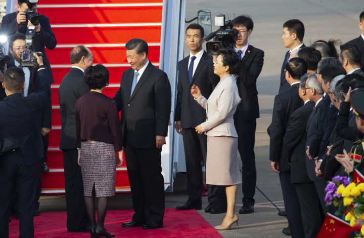 epa08083153 Chinese President Xi Jinping (C) shake hands with Macao's SAR Chief Executive Ho Iat Seng (L) as he leaves Macao after the Macao Special Administrative Region of the People's Republic of China 20th anniversary celebrations in Macao, China, 20 December 2019.  Macao had been a Portuguese colony until 1999 when it returned to Chinese rule under the 'one country, two systems' principle.  EPA/CARMO CORREIA